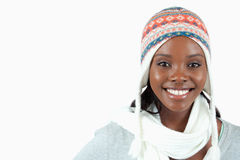 Smiling young woman with winter clothes on. Against a white background Royalty Free Stock Images