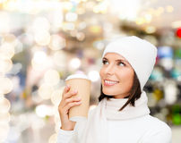 Smiling young woman in winter clothes with cup Royalty Free Stock Photos