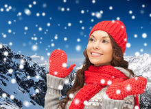 Smiling young woman in winter clothes Royalty Free Stock Image