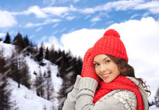 Smiling young woman in winter clothes Stock Photo