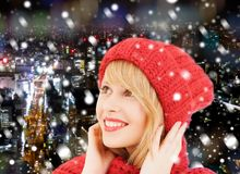 Smiling young woman in winter clothes royalty free stock photography