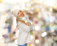 Smiling young woman in winter clothes Stock Photos