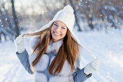Smiling young woman in winter cloves outdoor Stock Image