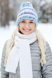Smiling young woman in winter forest Stock Photo