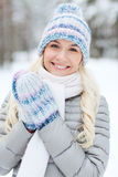 Smiling young woman in winter forest Stock Photography