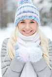 Smiling young woman in winter forest Royalty Free Stock Images