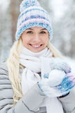 Smiling young woman in winter forest Royalty Free Stock Photos