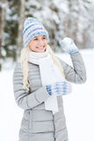 Smiling young woman in winter forest Stock Image