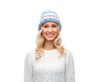 Smiling young woman in winter hat and sweater Stock Image