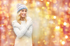 Smiling young woman in winter hat and sweater Royalty Free Stock Images