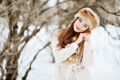 Smiling young woman in wintertime outdoor.  Royalty Free Stock Photos