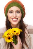 Smiling Young Woman With Yellow Flowers Stock Photos