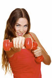 Smiling young woman working out Royalty Free Stock Image