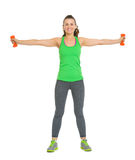 Smiling young woman workout with dumbbells Royalty Free Stock Photo
