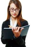Smiling young woman writing Stock Photos