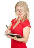 Smiling young woman  writing on black clipboard Royalty Free Stock Photography