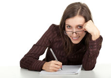 Smiling young woman writing on blank card Royalty Free Stock Photos
