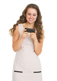Smiling young woman writing sms Stock Photography