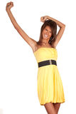 Smiling young woman in yellow dress Stock Image
