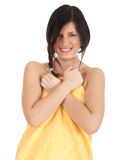 Smiling young woman in yellow towel Stock Photo