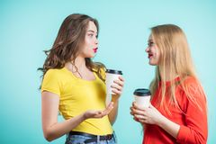 Smiling young women drinking coffee and talking. people, communication and friendship royalty free stock photo