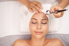 Oxygen therapy. Smiling young women getting oxygen therapy in beauty salon stock image