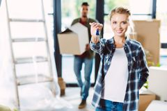 Couple with keys in new house Stock Image