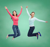 Smiling young women jumping in air Royalty Free Stock Image