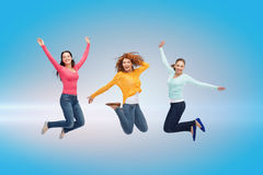 Smiling young women jumping in air Stock Photo