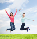 Smiling young women jumping in air Royalty Free Stock Photography