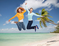 Smiling young women jumping in air Royalty Free Stock Photos