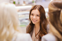 Smiling young women meeting and talking Royalty Free Stock Photo