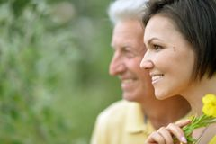 Young woman with senior man. Smiling young women with senior men outdoors stock image
