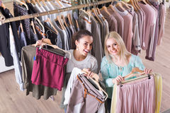 Smiling young women shopping. Smiling  women shopping at the clothing store Stock Images