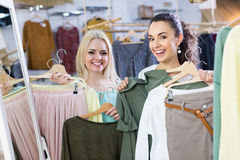 Smiling young women shopping Stock Photos