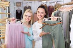 Smiling young women shopping Stock Photo