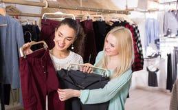 Smiling young women shopping pants Stock Photo