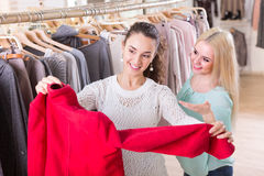 Smiling young women shopping. Positive young women shopping at the clothing store Stock Photography