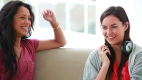 Smiling young women talking to each other stock video footage