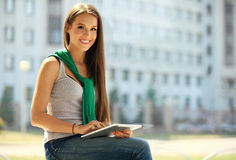 Smiling young women using digital tablet in office Royalty Free Stock Images