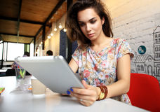 Smiling young women using digital tablet in office Royalty Free Stock Photos