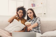 Free Smiling Young Women Watching Movie At Home Royalty Free Stock Image - 107318776