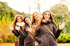 Smiling young women waving Stock Photography