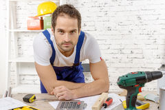 Smiling young worker in his workshop Stock Photography