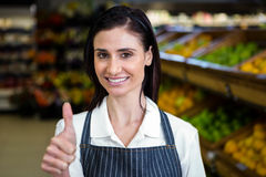 Smiling young worker with thumbs up Royalty Free Stock Image