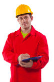 Smiling young worker wearing working clothes Stock Image