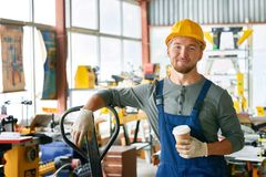 Free Smiling Young Workman On Break Stock Images - 103724624