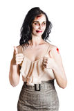 Zombie woman with thumbs up Royalty Free Stock Photos