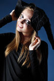 Smiling zombie girl with black tears and cut throat in hat Stock Photography