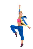 Smiling zumba instructor dancing. Smiling young female dancing zumba. Full length studio shot isolated on white Royalty Free Stock Photos